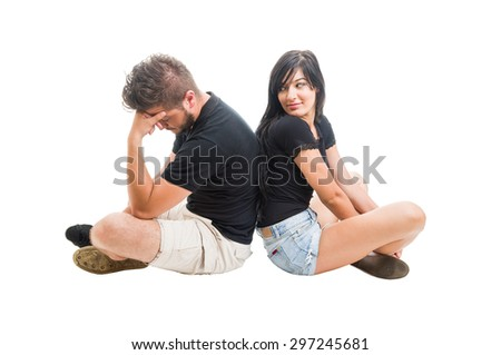 Young couple breaking up concept with boyfriend and girlfriend sitting behind each other - stock photo