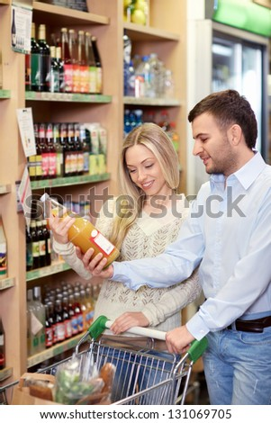 Young couple buying products in the store - stock photo