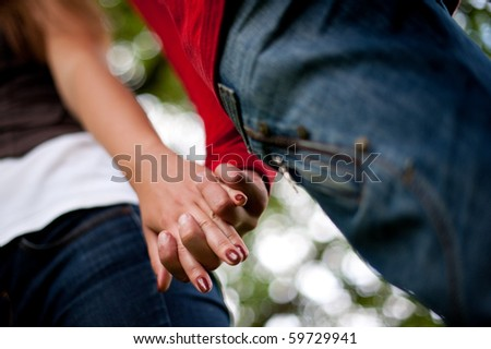Young couple by hand in hand