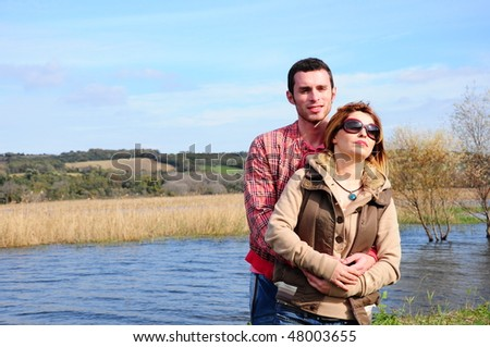 young couple by sea - stock photo