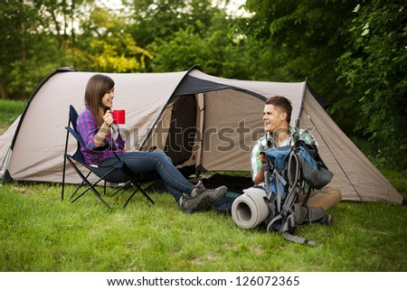 Young couple camping - stock photo
