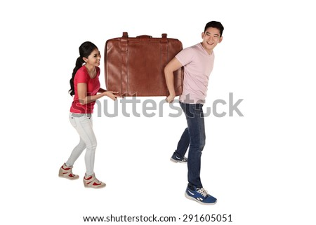 Young couple carrying baggage isolated over white background - stock photo