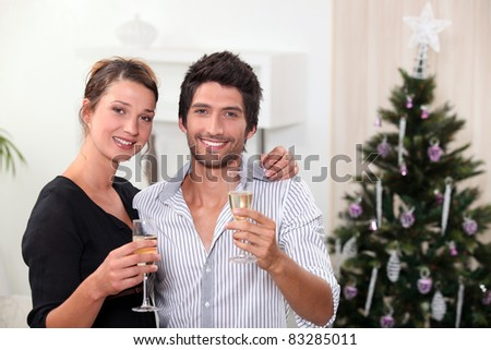 young couple celebrating New Year's Eve - stock photo