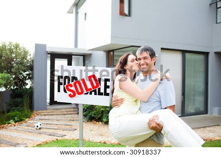 Young couple celebrating their new house