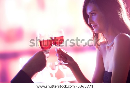 Young couple celebrating with red wine together - stock photo