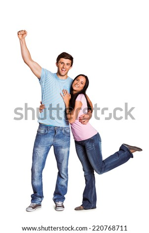 Young couple cheering at camera on white background