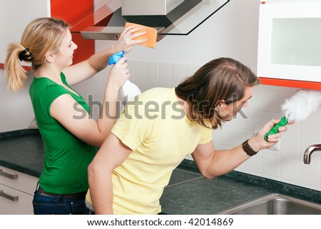 Young couple cleaning their apartment after moving in together - stock photo