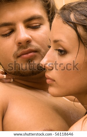 Young couple closeup portrait, focus on man - stock photo