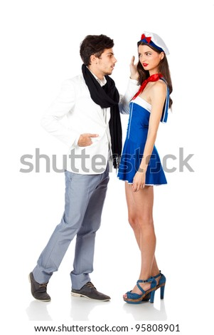 Young couple, confident young elegant man seducing sexy sailor woman. Isolated on white background. High resolution studio image - stock photo
