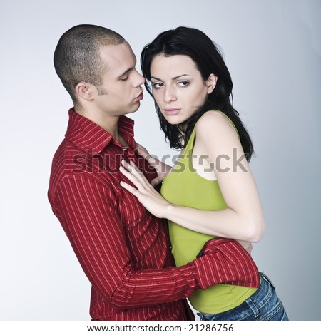 young couple conflict on isolated background - stock photo