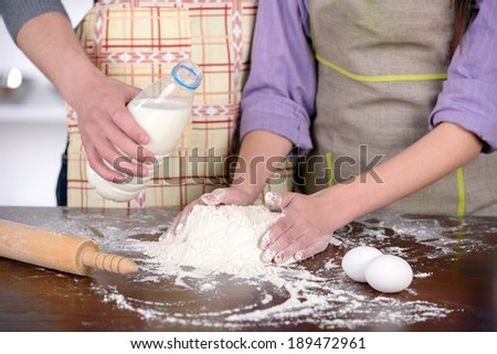 Young couple cooking in the kitchen in their homes