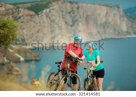 Young couple cycling - stock photo