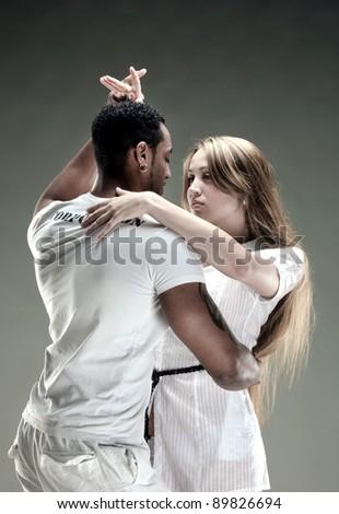 Young couple dances Salsa. Vintage photo. - stock photo