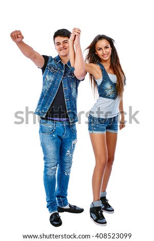 Young couple dancing and having fun. Isolated on white background. - stock photo