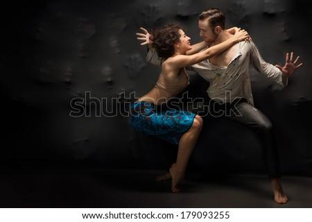 Young couple dancing contemporary. Studio photo - stock photo