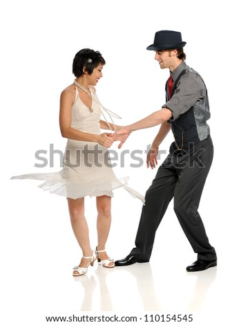 Young couple dancing isolated over white background - stock photo