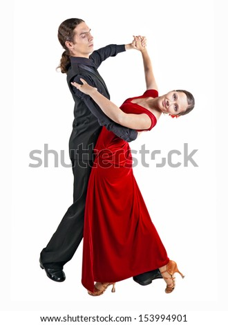 Young couple dancing waltz isolated over white background - stock photo