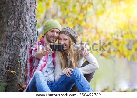 young couple dating in forest
