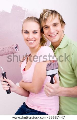young couple decorating home
