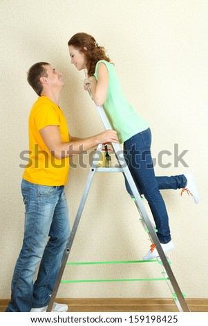 Young couple doing renovation in new house