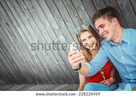Young couple doing selfie - stock photo