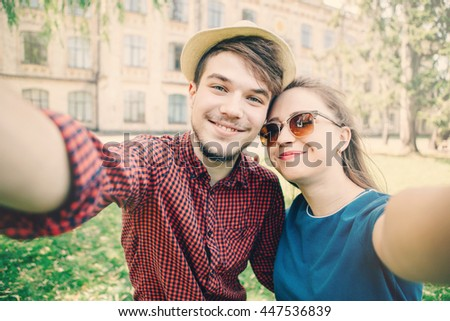 Young couple doing selfie. Travel. Lifestyle concept. Couple of young attractive tourists - stock photo