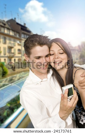 young couple doing tourism with digital camera