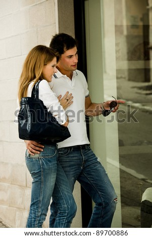 Young couple doing window shopping - stock photo