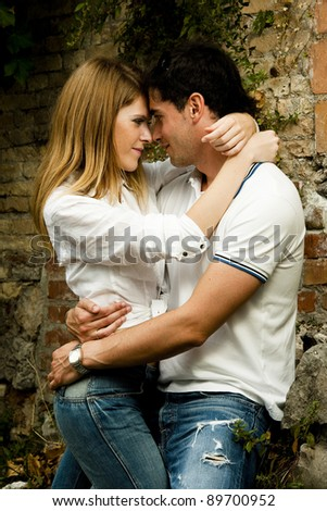 Young couple doing window shopping in love embracing - stock photo