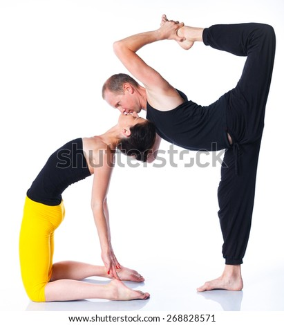Young couple doing yoga. Isolated on white backgraund - stock photo