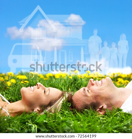 Young couple dreaming about a new car and a house - stock photo
