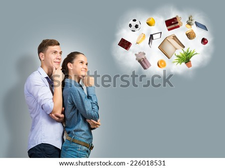 Young couple dreaming about future successful life - stock photo