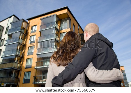 Young couple dreaming of a new home - stock photo