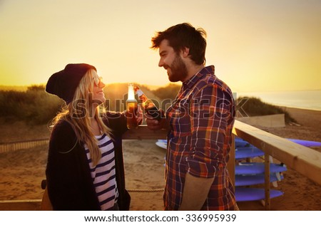 Young couple drinking - stock photo