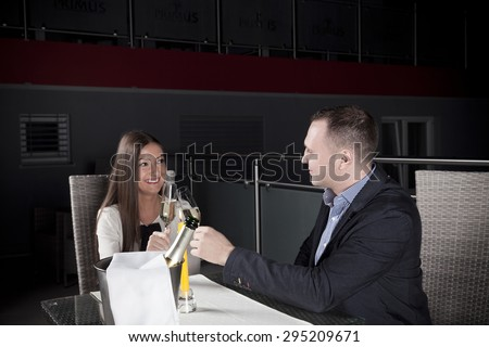 young couple drinking champagne and toasting - stock photo