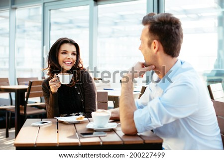 Young couple drinking some coffee - stock photo