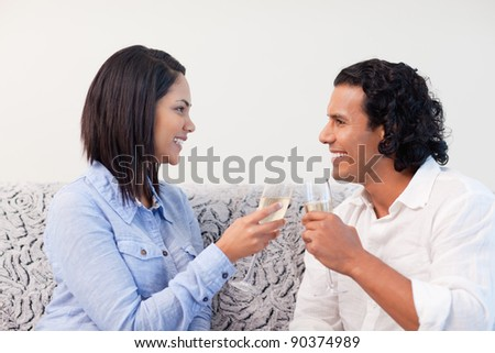 Young couple drinking sparkling wine