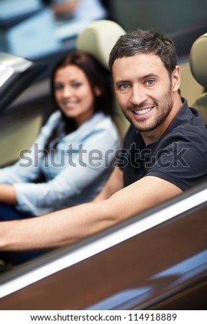 Young couple driving a car - stock photo