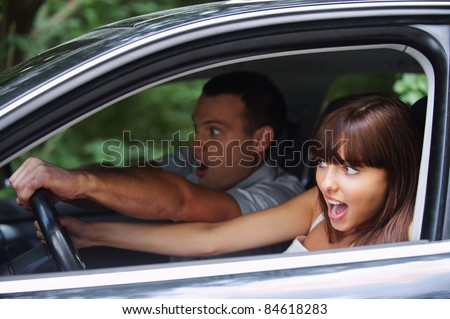 Young couple driving car on high speed. - stock photo