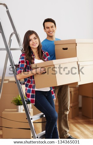 Young couple during moving in home - stock photo