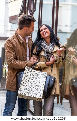 young couple einkausbummel. shopping in the city is fun - stock photo