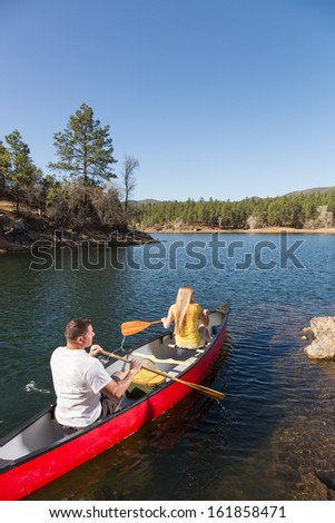 Young Couple Embarks on a Canoe Trip