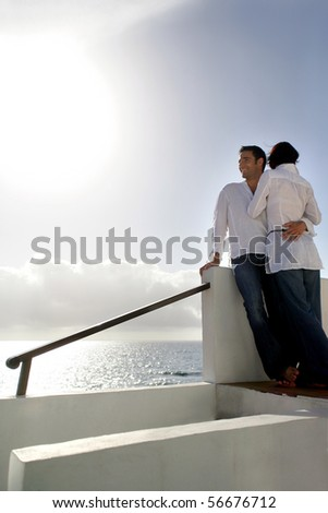 Young couple embraced on a terrace - stock photo