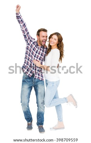 Young couple embracing and posing on white background - stock photo