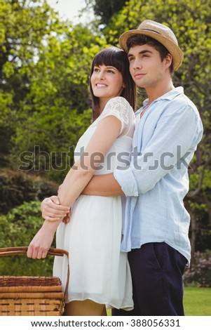 Young couple embracing each other in garden