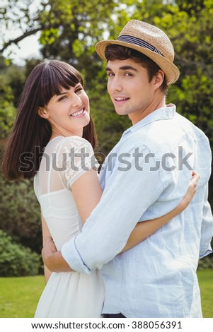 Young couple embracing each other in garden - stock photo