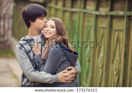 Young couple embracing in a city - stock photo