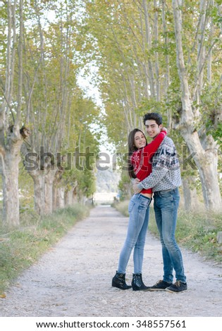 Young couple embracing on the nature