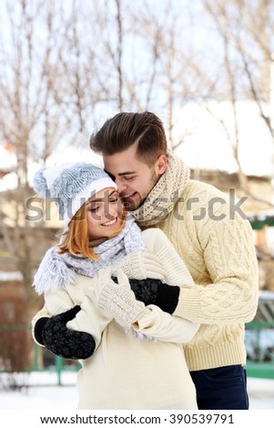 Young couple embracing outdoors in winter