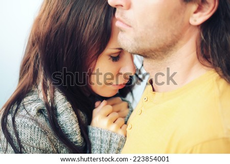 Young couple embracing. Photo toned style Instagram filters. - stock photo